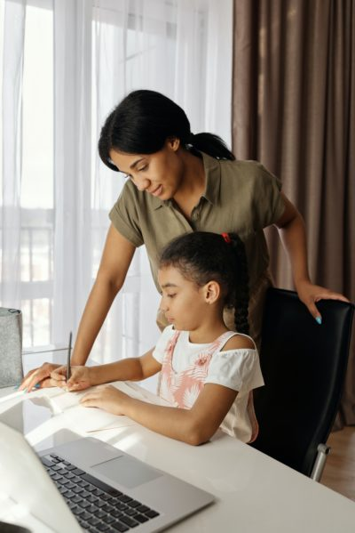 woman homeschooling her child