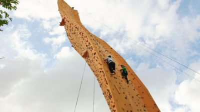 Bradley and barney walsh on climbing wall