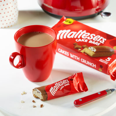 maltesters cake bars next to a cup of tea