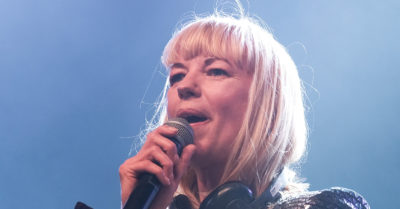 sara cox on stage as a dj