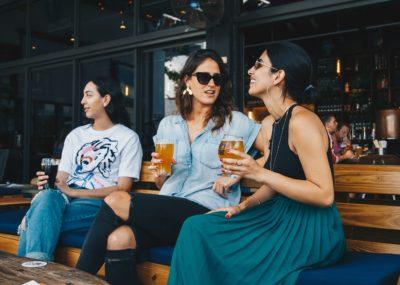 women sitting outside a pub