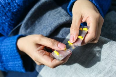 woman with pill packet
