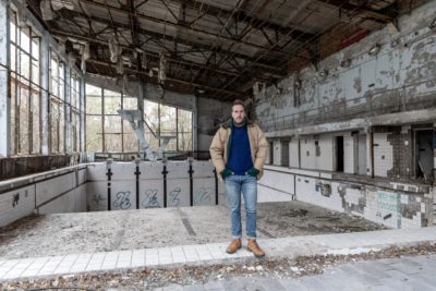 Ben Fogle inside the ruins of the Azure swimming pool in Pripyat (Credit: Channel 5)