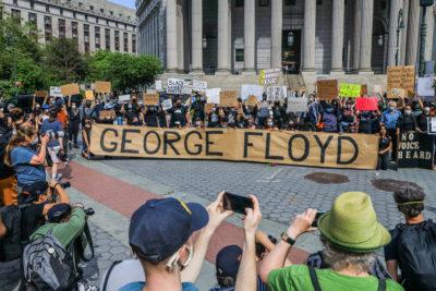 Protesters at a Black Lives Matter demonstration after the death of George Floyd (Credit: Vanessa Carvalho/Splash)