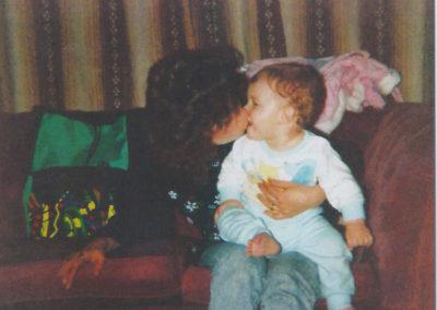 Denise kisses her baby son James (Credit: Denise Bulger / ITN Productions)