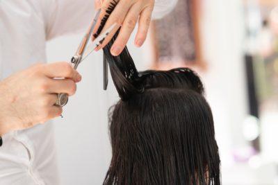 someone getting their hair cut