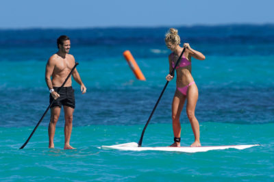 Vogue and Spencer paddling at Edens Rock resort in St Barts (Credit: Splash)