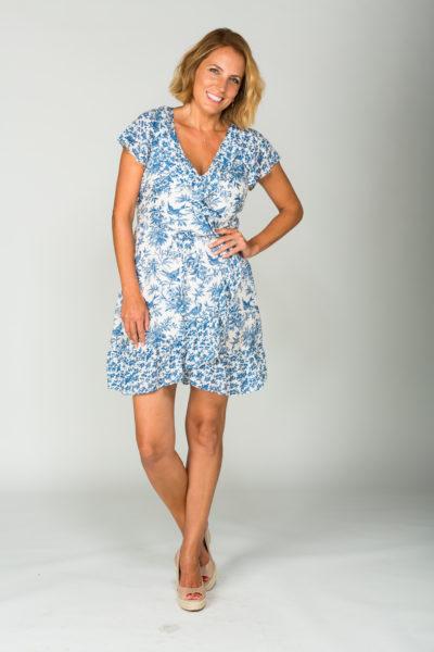 jasmine harman in a blue dress