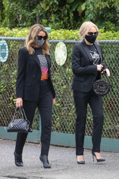 Kylie and Dannii attending the funeral of music mogul Michael Gudinski in Melbourne (Credit: Splash)