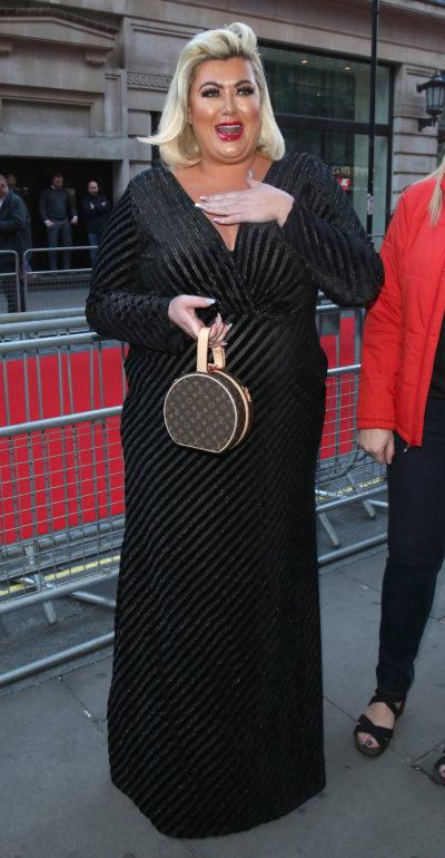 gemma collins in black floor-length dress