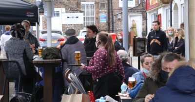 People drinking outdoors