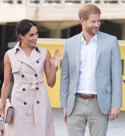 Meghan Markle smiles alongside Prince Harry