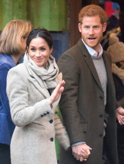 Meghan Markle and Prince Harry wave to fans