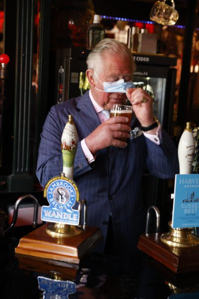 Prince Charles and Camilla out today - Prince enjoys pint