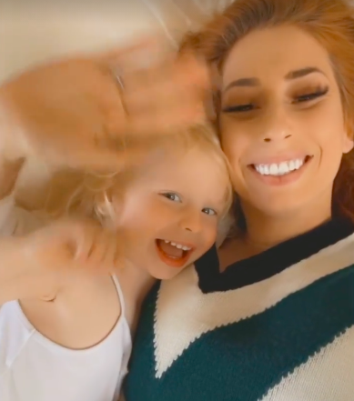 Stacey Solomon and her son Rex wave good morning
