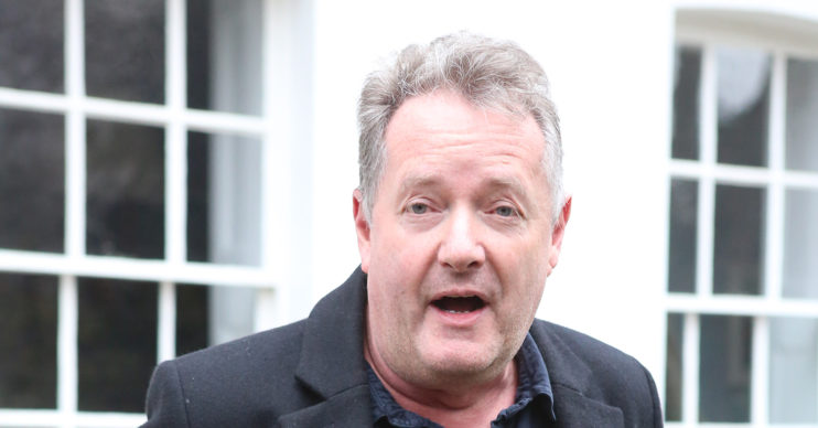 Piers Morgan standing outside a building
