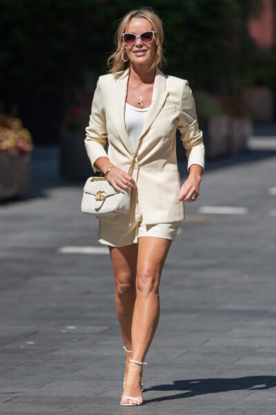 Amanda Holden shows off her legs as she steps out in tiny shorts