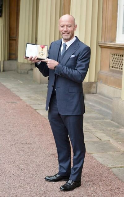 Alan Shearer poses with his CBE