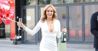 Amanda Holden holding a birthday balloon and a bottle of bubbly