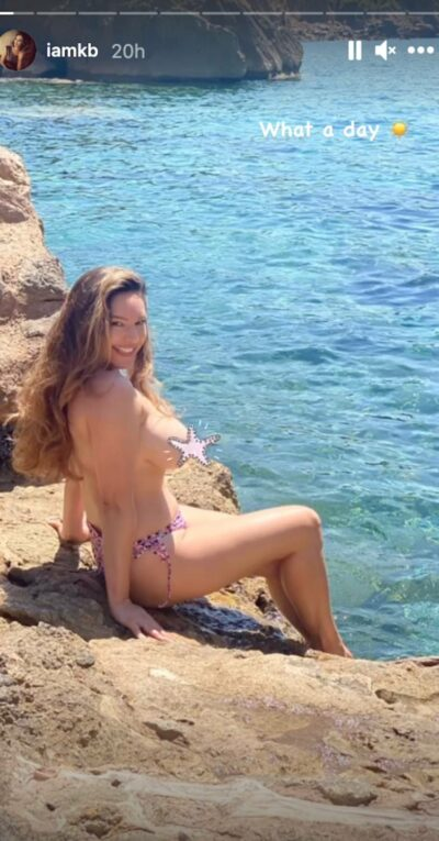 Kelly Brook causes a frenzy on Instagram as she poses topless in holiday pics