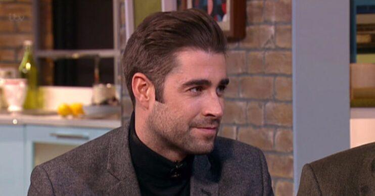 Matt Johnson smiling during TV appearance
