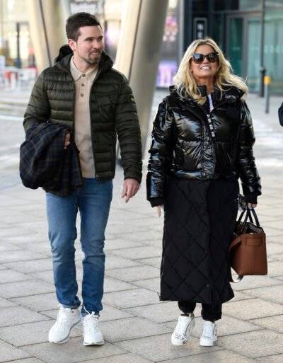 kerry katona and fiance ryan mahoney walking down the street