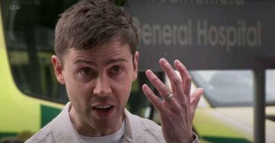 Coronation Street's Todd holds up his hand to show he is still wearing his ring