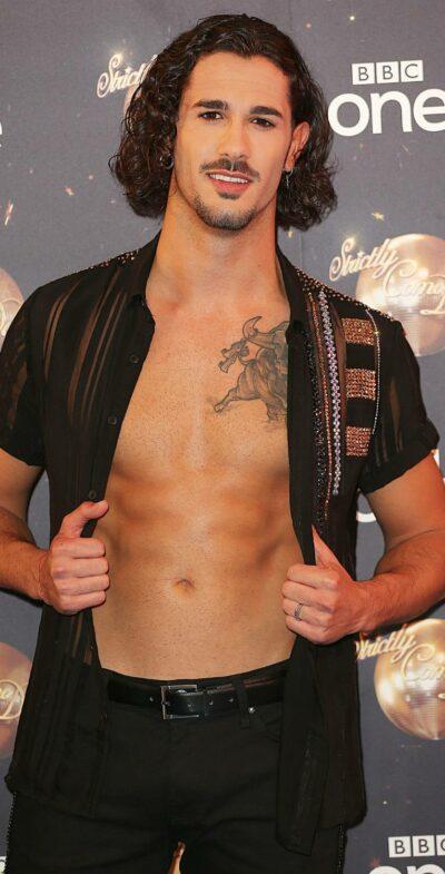 Graziano Di Prima shows off his chest