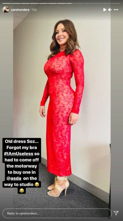 Carol vorderman poses in a red lace dress backstage at Beat The Chasers