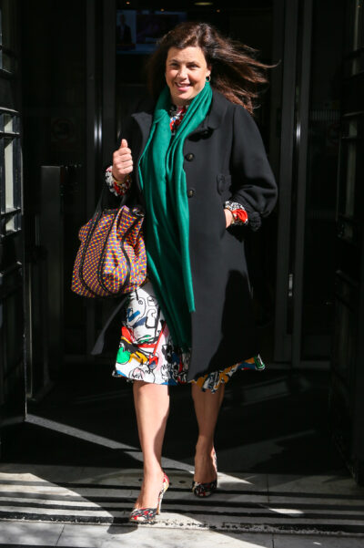 Kirstie Allsopp wearing a coat and green scarf