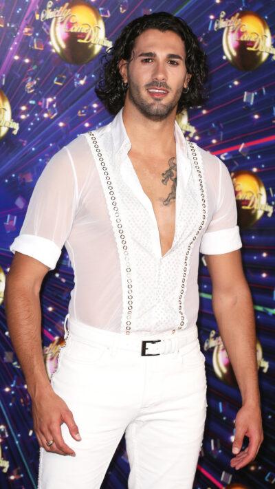 Graziano Di Prima dressed all in white