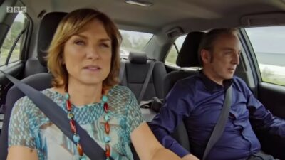 Fiona Bruce and Phillip Mould in a car on their show Fake Or Fortune