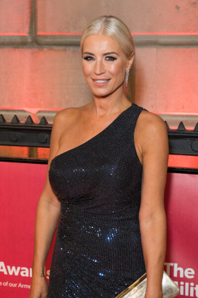 Denise Van Outen with her hair slicked back wearing a one shoulder black sequin dress and smiling