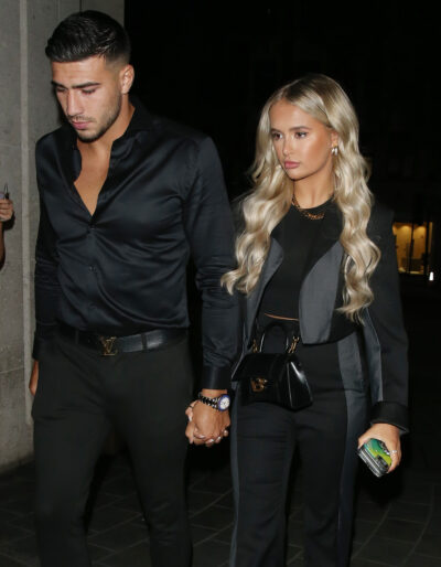 Molly-Mae Hague and Tommy Fury holding hands on a night out