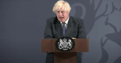 Boris Johnson speaks from a lectern
