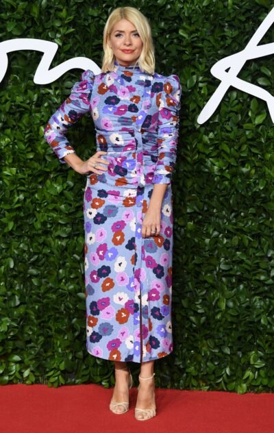 Holly Willoughby wearing a floral evening gown on the red carpet