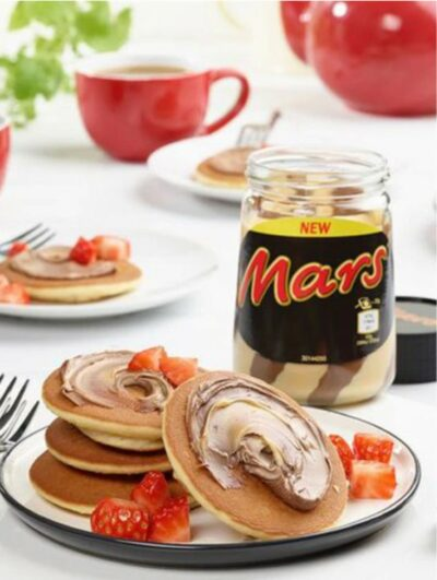New Mars bar flavour spread in a jar with pancakes