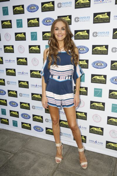 Big Brother star Nikki Grahame smiles for the cameras at an event