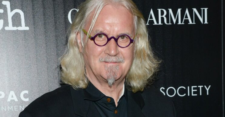 Sir Billy Connolly smiles on red carpet