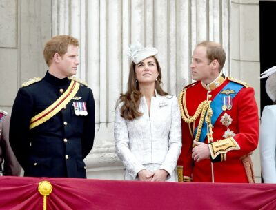 Prince Harry chats to Kate Middleton and Prince William on the Buckingham Palace balcony