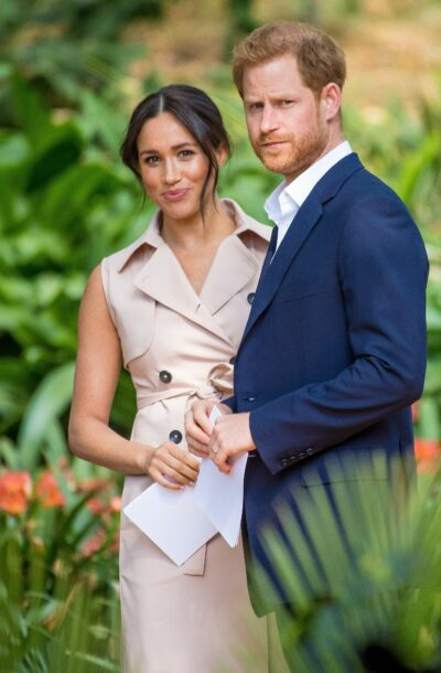 Meghan Markle and Prince Harry look towards the camera during royal engagement