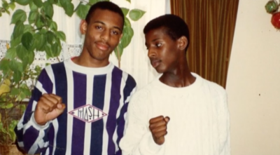 Stephen Lawrence in striped shirt