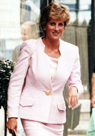 Princess Diana smiles as she steps out in front of cameras