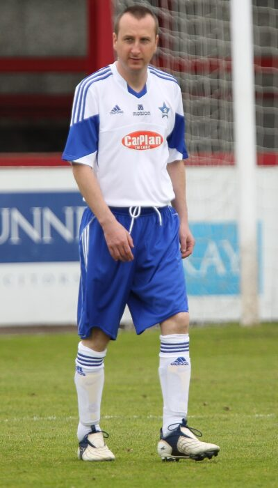Andy whyment dressed in a soccer aid football kit