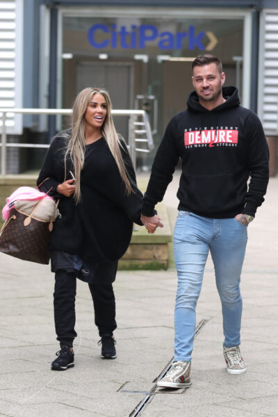 Katie Price And Carl Woods walk holding hands