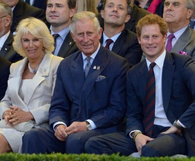 Camilla, Prince Charles and Prince Harry smile at cameras