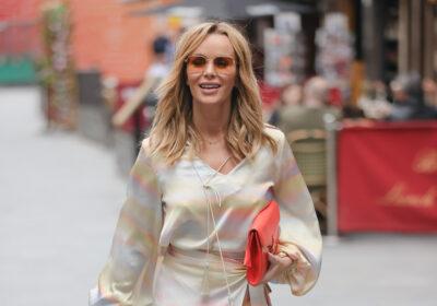 Amanda Holden walking in a silky dress