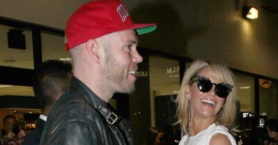 Sarah Harding at the airport with Mark Foster