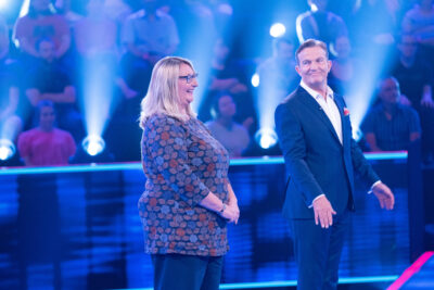 Bradley Walsh stands with a contestant on Beat the Chasers