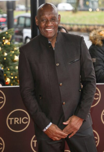 The Chase star Shaun Wallace smiles on red carpet